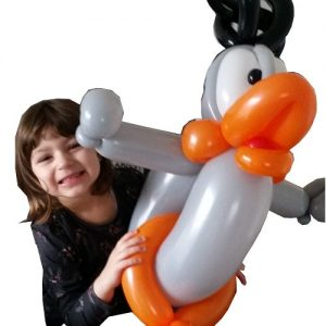 Girl enjoying a balloon built by Nck Twist - Balloon modeller in norwich.