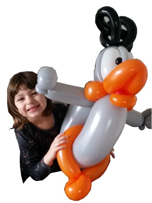 Girl enjoying a balloon built by Nck Twist - Balloon modeller in norwich.