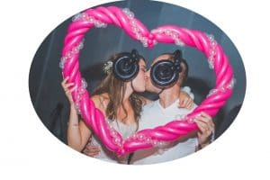 Wedding couple kissing in a balloon heart photo frame. Wedding gift in Norwich