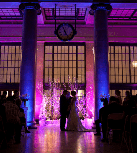 using purpe uplighting at a wedding