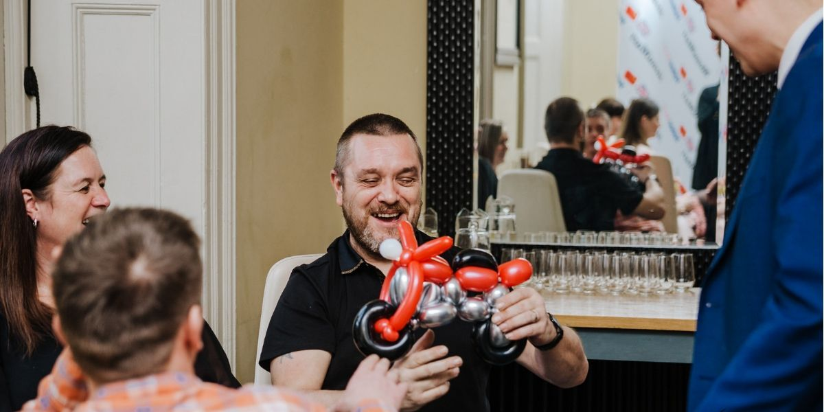 Wedding guests amazed by balloon art