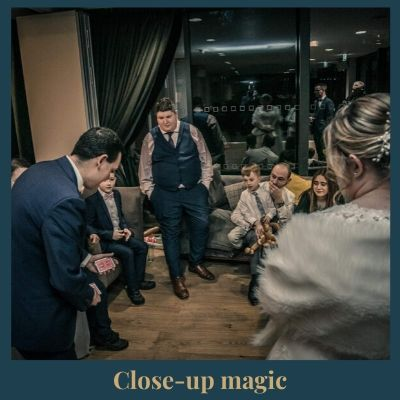 magician at a party with guests