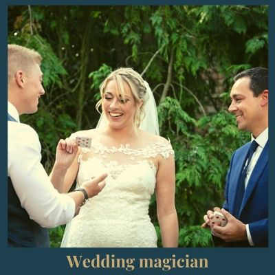 Magician entertaining bride and groom at wedding