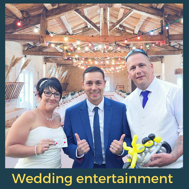 magician with a bride and groom in a barn