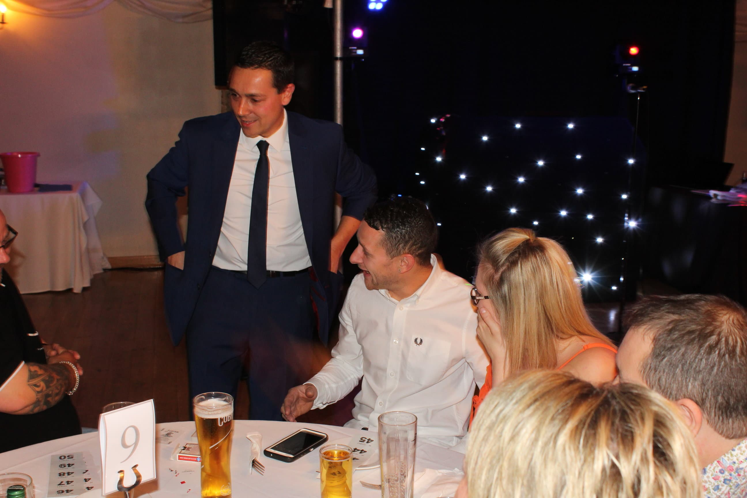 Nick Twist party magician laughing with guests