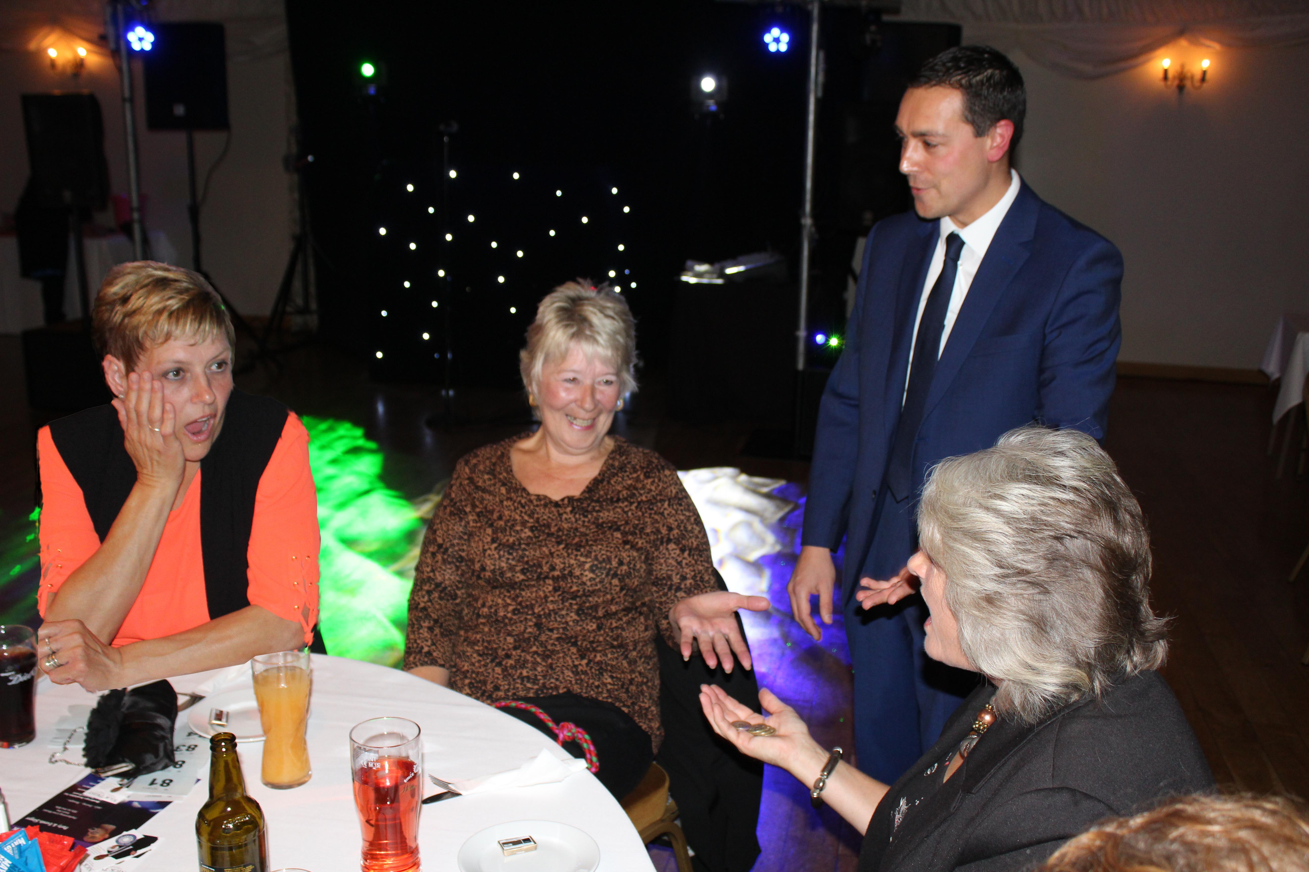 Nick Twist amazing some wonen at a wedding: Norfolk based magician