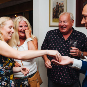 Group laughing with Nick- wedding magician at Wensum valley Hotel Norwich