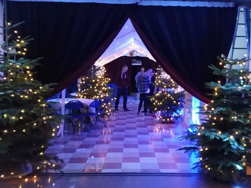 Christmas party with tress in tunnel