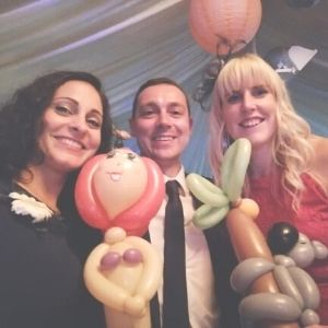 Adults with balloons at wedding
